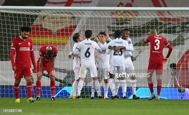 Eder Militao of Real Madrid celebrates victory with team mates following the UEFA Champions League Quarter Final Second Leg match between Liverpool...