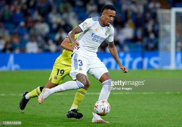 Eder Militao of Real Madrid CF and Francis Coquelin of Villarreal CF battle for the ball during the LaLiga Santander match between Real Madrid CF and...