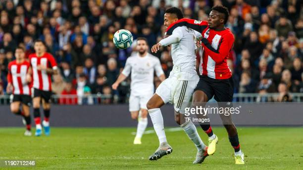 Eder Militao of Real Madrid CF Iñali Willians of Athletic Club Bilbao battle for the ball during the Liga match between Real Madrid CF and Athletic...