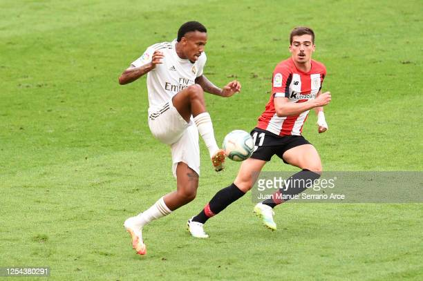 Eder Militao of Real Madrid controls the ball under pressure from Inigo Cordoba of Athletic Club during the La Liga match between Athletic Club and...