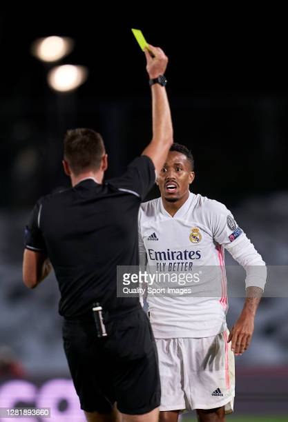 Eder Militao of Real Madrid gets yellow card during the UEFA Champions League Group B stage match between Real Madrid and Shakhtar Donetsk at Estadio...