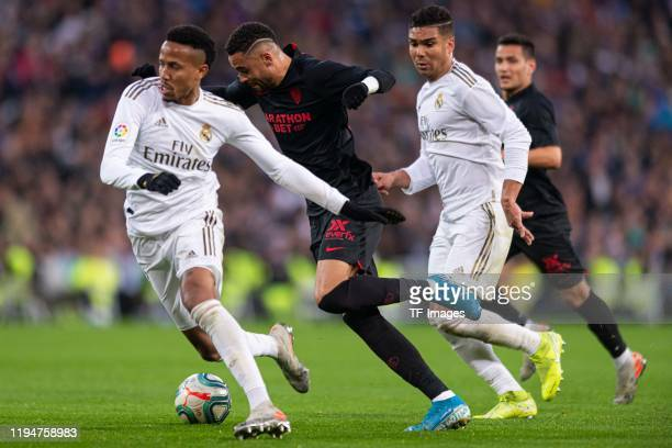 Eder Militao of Real Madrid Youssef EnNesyri of FC Sevilla and Casemiro of Real Madrid battle for the ball during the Liga match between Real Madrid...