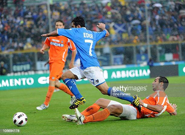 Eder of Brescia battles for the ball with Mehdi Benatia of Udinese during the Serie A match between Brescia Calcio and Udinese Calcio at Mario...