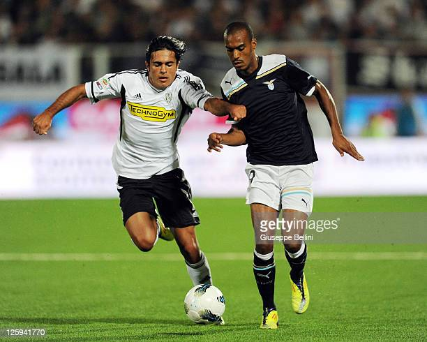 Eder of Cesena and Abdoulay Konko of Lazio in action during the Serie A match between AC Cesena and SS Lazio at Dino Manuzzi Stadium on September 21...