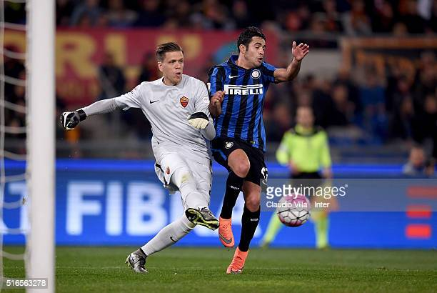 Eder of FC Internazionale and Wojciech Szczesny of AS Roma compete for the ball during the Serie A match between AS Roma and FC Internazionale Milano...