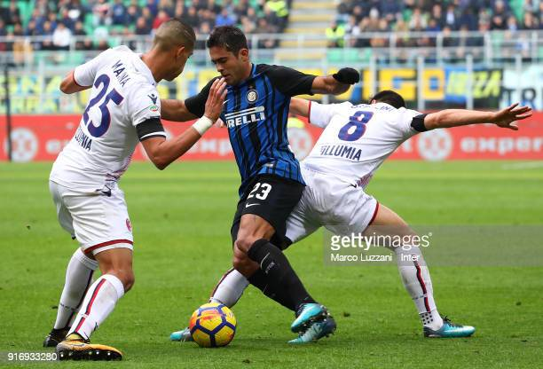 Eder of FC Internazionale competes for the ball with Adam Masina and Riccardo Orsolini of Bologna FC during the serie A match between FC...