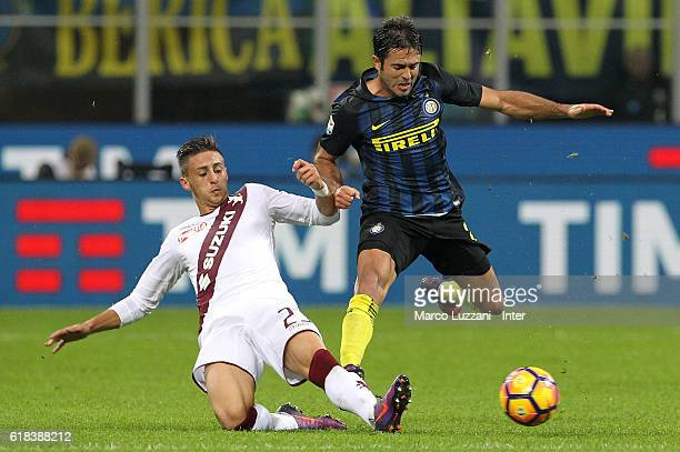 Eder of FC Internazionale competes for the ball with Antonio Barrecai of FC Torinol during the Serie A match between FC Internazionale and FC Torino...