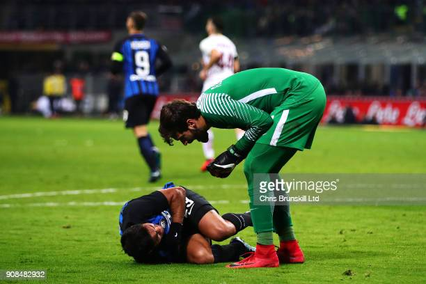 Eder of FC Internazionale lies injured as Alisson of AS Roma stands over him during the Serie A match between FC Internazionale and AS Roma at Stadio...