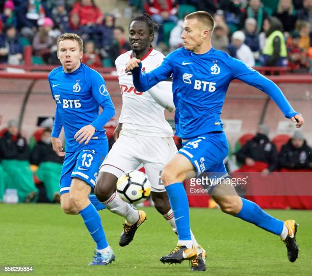 Eder of FC Lokomotiv Moscow vies for the ball with Maksim Kuzmin and Toni Sunjic of FC Dinamo Moscow during the Russian Premier League match between...