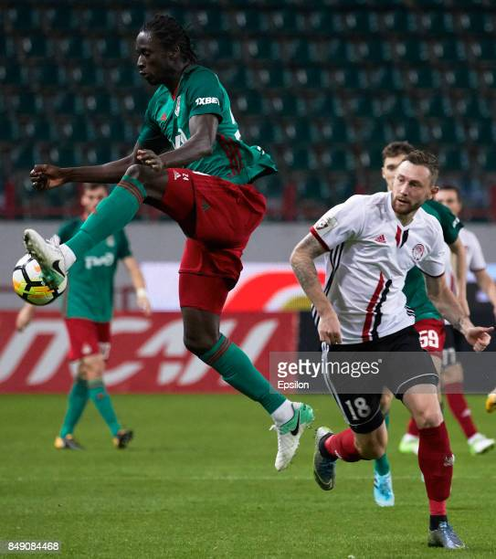 Eder of FC Lokomotiv Moscow vies for the ball with Mikhail Sivakov of FC Amkar Perm during the Russian Premier League match between FC Lokomotiv...
