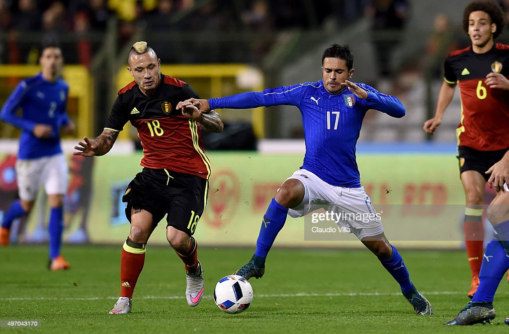 Eder of Italy and Radja Nainggolan of Belgium #18 compete for the ball during the intermational friendly match between Belgium and Italy at King Baudouin Stadium on November 13, 2015 in Brussels, Belgium.