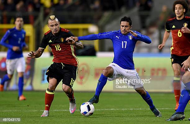 Eder of Italy and Radja Nainggolan of Belgium compete for the ball during the intermational friendly match between Belgium and Italy at King Baudouin...