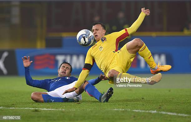 Eder of Italy and Vlad Chiriches of Romania compete for the ball during the international friendly match between Italy and Romania at Stadio Renato...