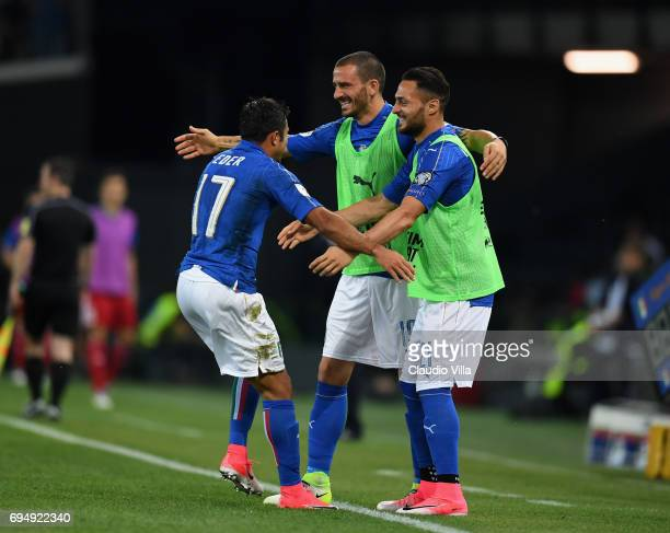 Eder of Italy celebrates with Leonardo Bonucci and Danilo D'Ambrosio after scoring the third goal during the FIFA 2018 World Cup Qualifier between...