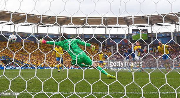 Eder of Italy scores past Andreas Isaksson of Sweden for his sides first goal during the UEFA EURO 2016 Group E match between Italy and Sweden at...