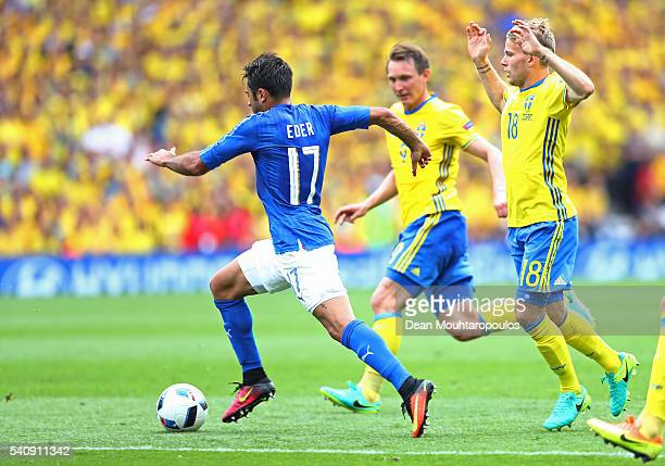 Eder of Italy takes on Oscar Lewicki of Sweden in the build up to his opening goal during the UEFA EURO 2016 Group E match between Italy and Sweden...