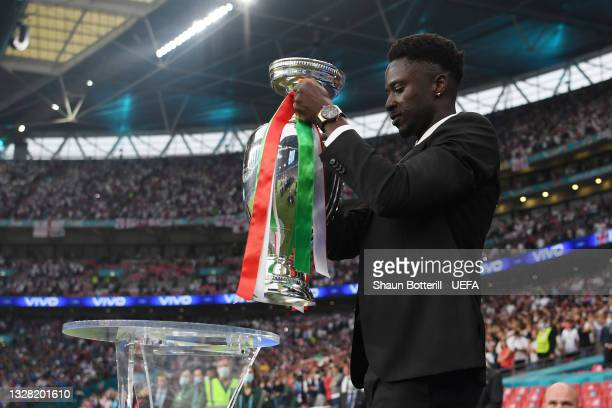 Eder of Portugal, who scored the winning goal for Portugal in UEFA Euro 2016 final carries The Henri Delaunay Trophy out to the pitch prior to the...