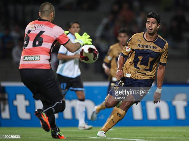 Eder Patino of Merida struggles for the ball with Eduardo Herrera of Pumas during a match between Pumas and Merida as part of the Copa MX 2012 at...