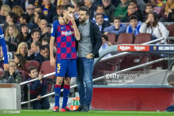 Eder Sarabia assistant coach of Barcelona talking with Sergio Busquets of Barcelona on the sideline during the Barcelona V Real Sociedad La Liga...