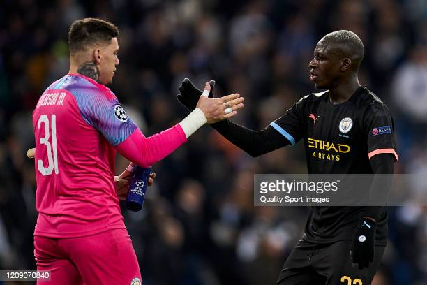 Ederson and Benjamin Mendy of Manchester City salutes during the UEFA Champions League round of 16 first leg match between Real Madrid and Manchester...