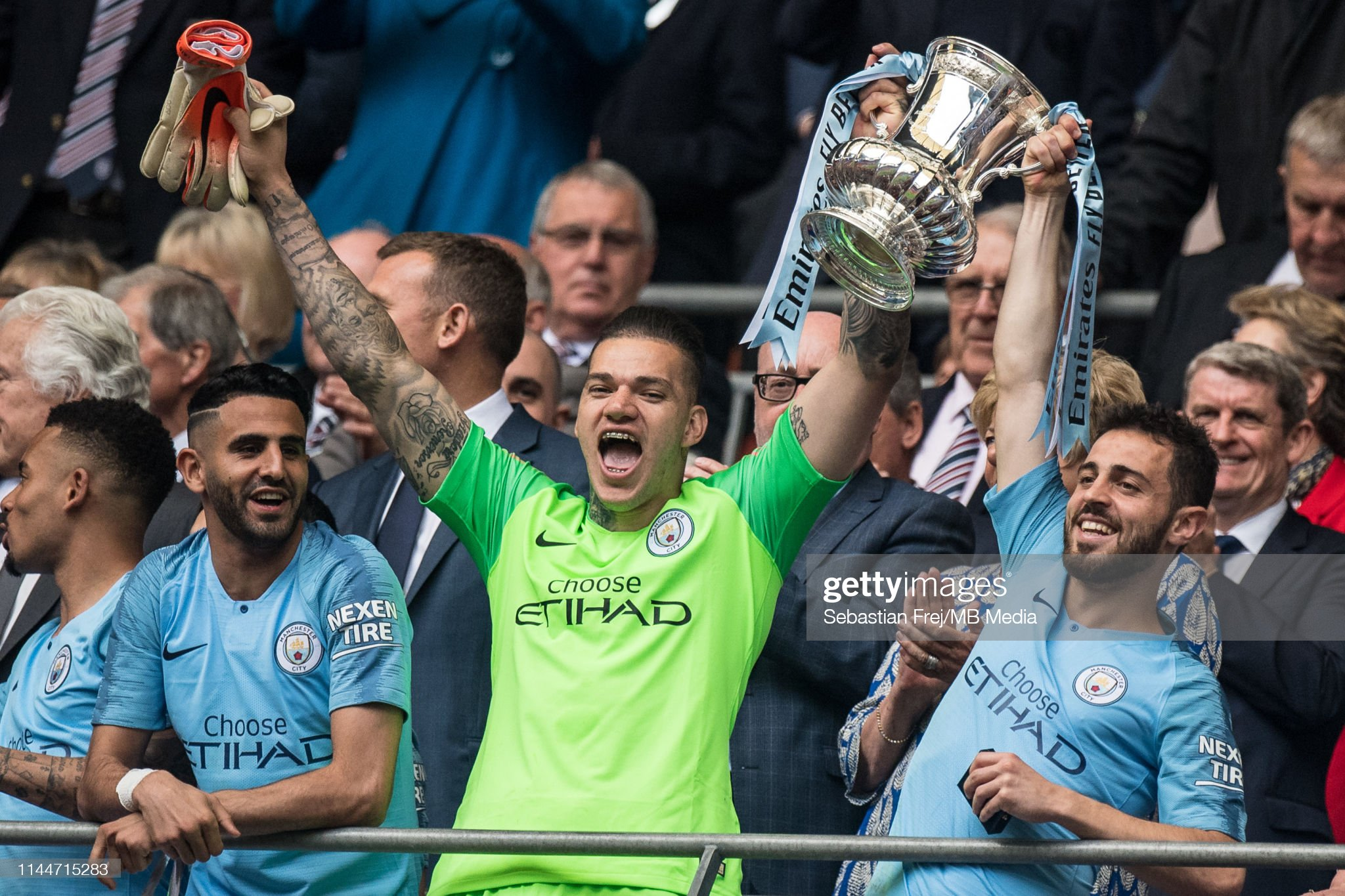 https://media.gettyimages.com/photos/ederson-and-bernardo-silva-of-manchester-city-with-fa-trophy-during-picture-id1144715283?s=2048x2048
