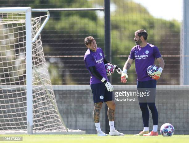 Ederson and Carson talk during Manchester City training session on August 13 2020 in Lisbon Portugal