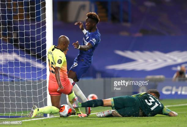 Ederson and Fernandinho of Manchester City block a shot from Tammy Abraham of Chelsea during the Premier League match between Chelsea FC and...