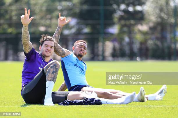 Ederson and Gabriel Jesus of Manchester City pose for a photo during a training session at Manchester City Football Academy on July 31, 2020 in...