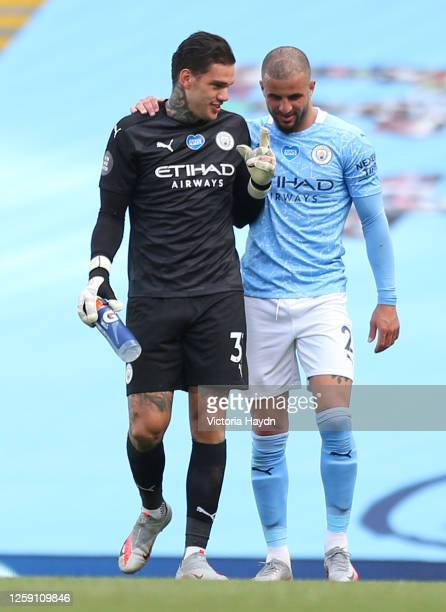 Ederson and Kyle Walker both of Manchester City talk after the Premier League match between Manchester City and Norwich City at Etihad Stadium on...