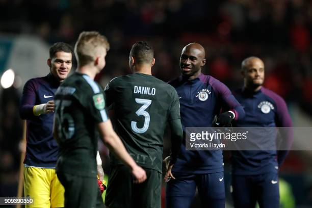 Ederson Danilo and Eliaquim Mangala of Manchester City celebrate victory with team mates after the Carabao Cup semifinal second leg match between...