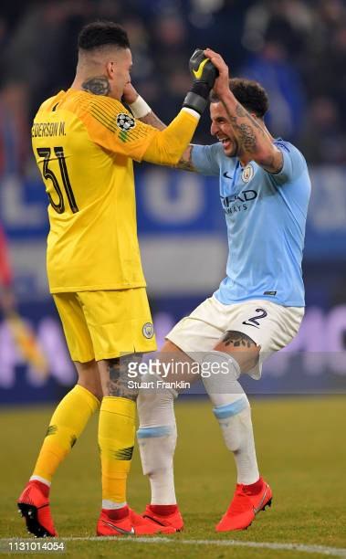 Ederson goalkeeper of Manchester City celebrate with Kyle Walker after the UEFA Champions League Round of 16 First Leg match between FC Schalke 04...