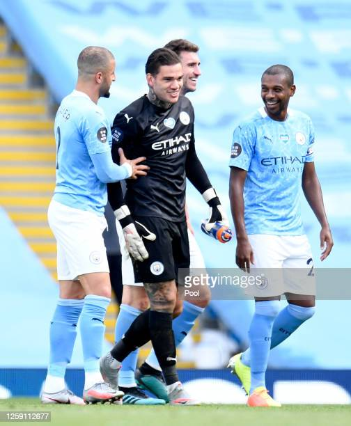Ederson Kyle Walker Fernandinho and Aymeric Laporte all of Manchester City celebrate during the Premier League match between Manchester City and...