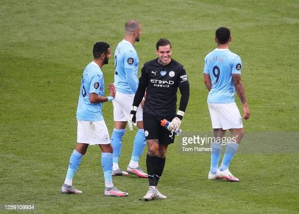 Ederson, Kyle Walker, Riyad Mahrez and Gabriel Jesus all of Manchester City celebrate after the Premier League match between Manchester City and...