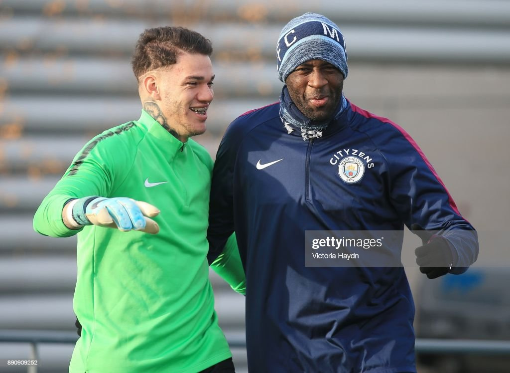 Ederson Moraes and Yaya Toure react during trainig at Manchester City Football Academy on December 12, 2017 in Manchester, England.