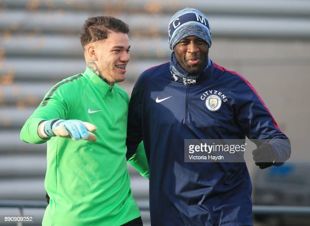 Ederson Moraes and Yaya Toure react during trainig at Manchester City Football Academy on December 12 2017 in Manchester England