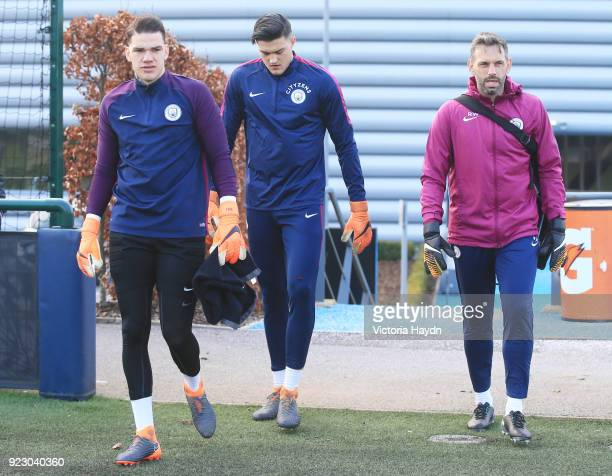 Ederson Moraes Aro Muric and Richard Wright walk out to training at Manchester City Football Academy on February 22 2018 in Manchester England