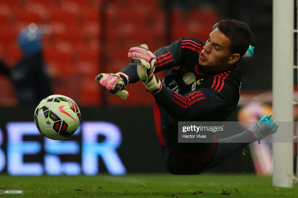 Ederson Moraes of Benfica dives to stop a penalty kick during a match between America and Benfica as part of the International Champions Cup 2015 at Azteca Stadium on July 28, 2015 in Mexico City, Mexico.