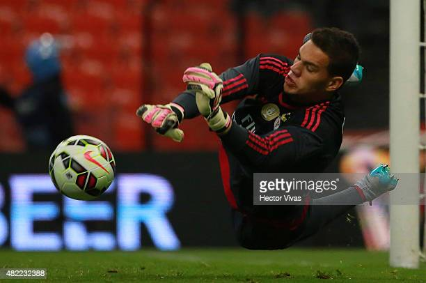 Ederson Moraes of Benfica dives to stop a penalty kick during a match between America and Benfica as part of the International Champions Cup 2015 at...