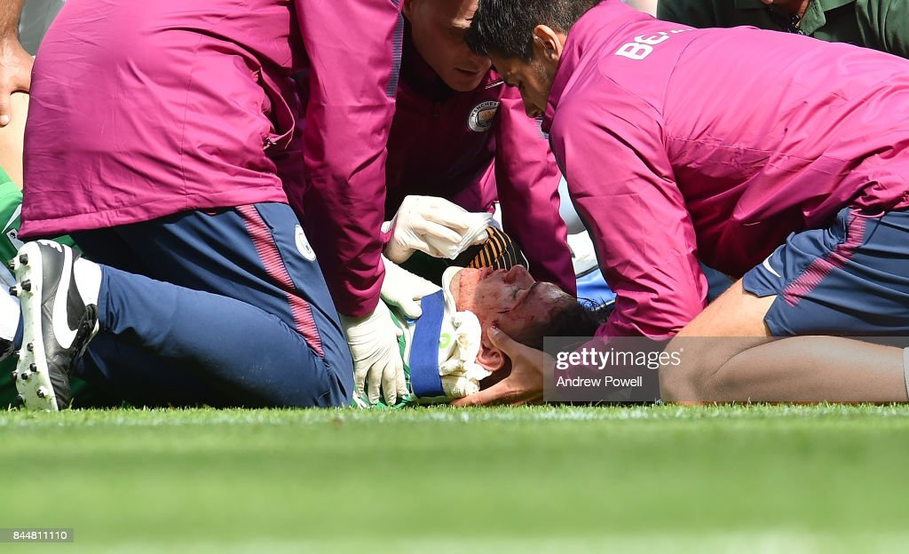 Ederson Moraes of Manchester City after being kicked in the face by Sadio Mane during the Premier League match between Manchester City and Liverpool at Etihad Stadium on September 9, 2017 in Manchester, England.