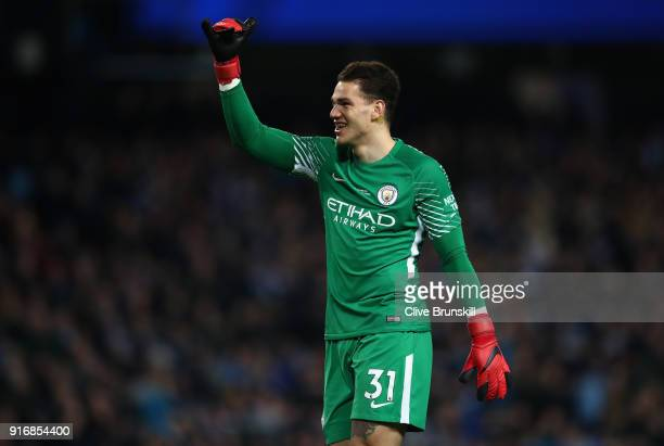 Ederson Moraes of Manchester City celebrates his teams first goal during the Premier League match between Manchester City and Leicester City at...