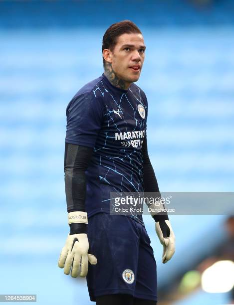 Ederson Moraes of Manchester City warms up ahead of the UEFA Champions League round of 16 second leg match between Manchester City and Real Madrid at...