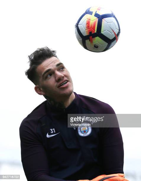 Ederson Moraes reacts during training at Manchester City Football Academy on April 6 2018 in Manchester England