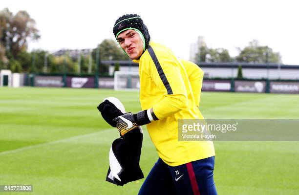 Ederson Moraes runs on to the pitch before training at Manchester City Football Academy on September 11 2017 in Manchester England
