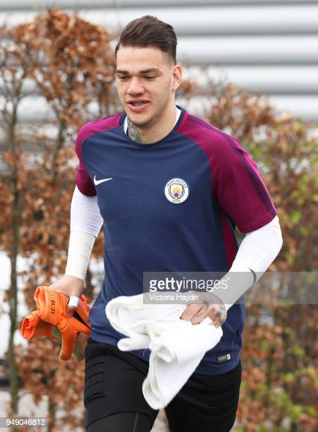Ederson Moraes runs to training at Manchester City Football Academy on April 20 2018 in Manchester England