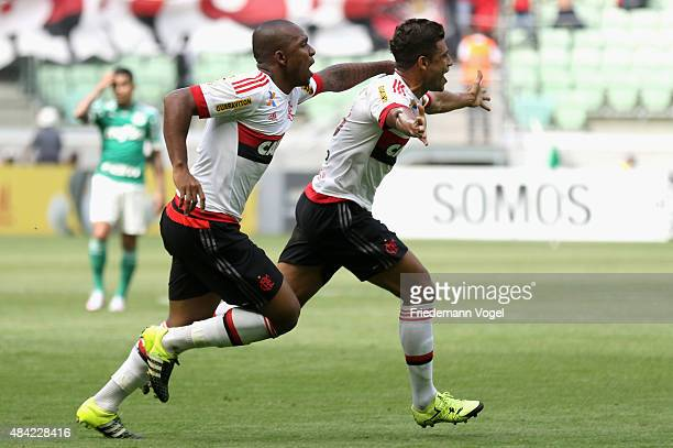 Ederson of Flamengo celebrates scoring the second goal with Samir during the match between Palmeiras and Flamengo for the Brazilian Series A 2015 at...