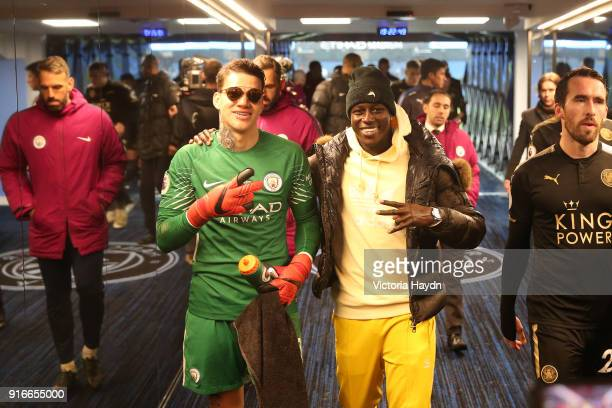 Ederson of Manchester City and Benjamin Mendy of Manchester City celebrate victory together in the tunnel after the Premier League match between...