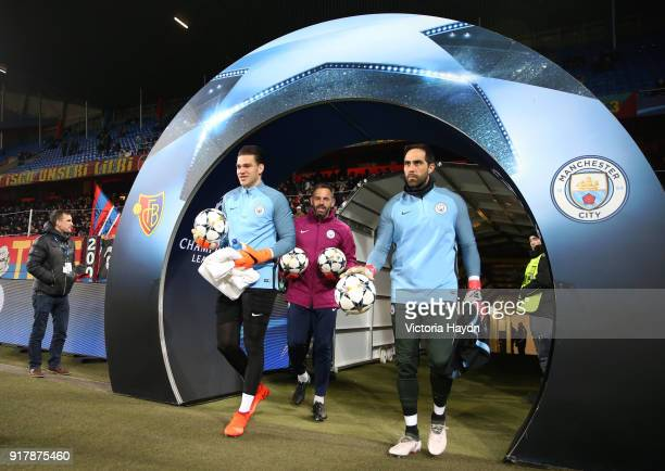Ederson of Manchester City and Claudio Bravo of Manchester City walk out to warm up prior to the UEFA Champions League Round of 16 First Leg match...