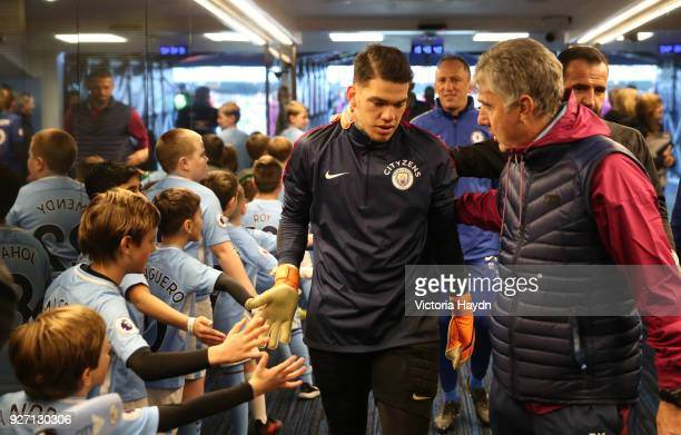 Ederson of Manchester City arrives ahead of during the Premier League match between Manchester City and Chelsea at Etihad Stadium on March 4 2018 in...