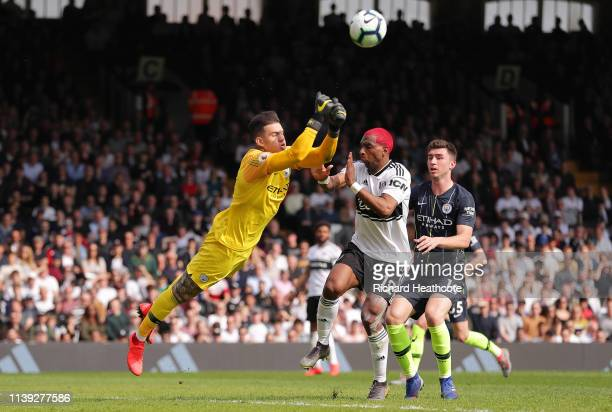 Ederson of Manchester City battles for possession with Ryan Babel of Fulham during the Premier League match between Fulham FC and Manchester City at...