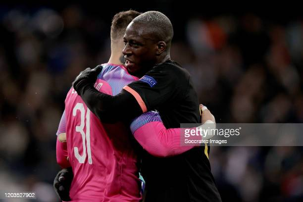 Ederson of Manchester City Benjamin Mendy of Manchester City celebrates the victory during the UEFA Champions League match between Real Madrid v...
